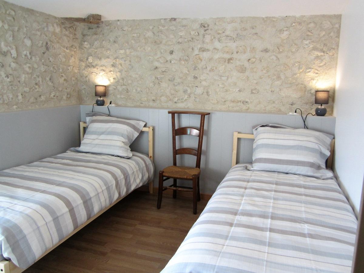 slaapkamer met 2-éénpersoonbedden